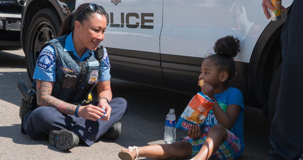 Policewoman with girl